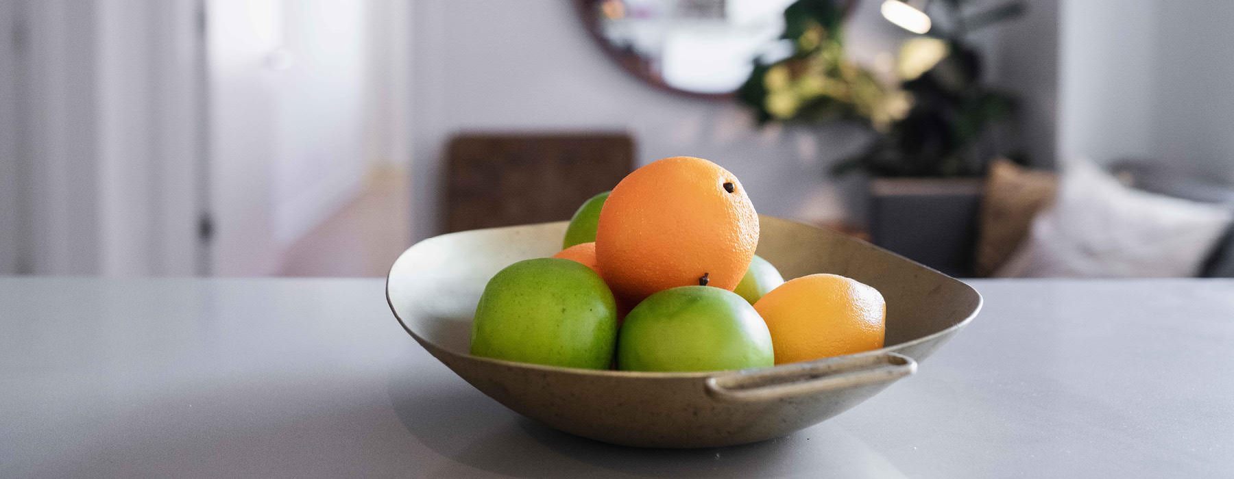 bowl of fruit sits on kitchen counter